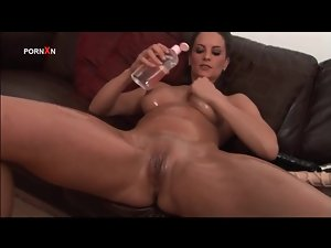 She coats her body in sexy oil and fucks hole with toy