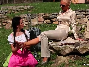 Foot massage outdoors for her sexy mistress