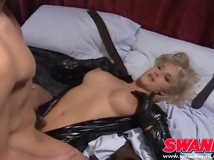 Cocksucking blonde in a black latex catsuit