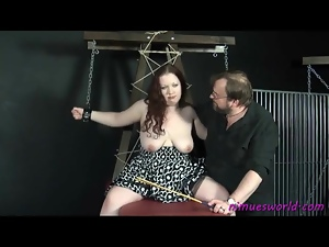 Chained up fat chick in a dress suffers