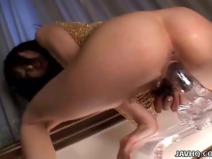Japanese babe playing with a big dildo uncensored