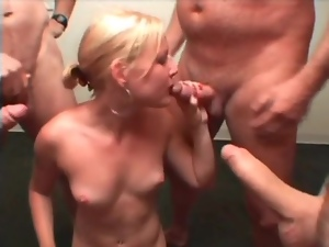 Blonde surrounded by dick and sucking lustily