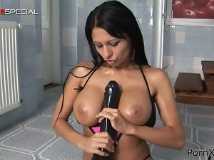 Brunette latina plays with a massive dildo