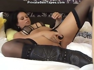 Babe in stockings gets her ass toyed and fucked