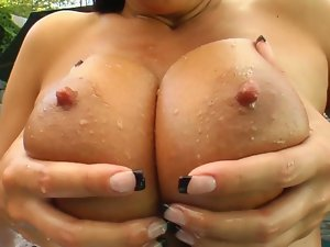 Busty mandy masturbates in the backyard