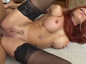 Redhead milf is fucked by a big hard cock