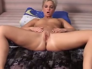 Shorthaired german blonde plays with her pussy