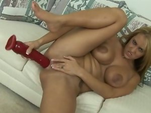 Horny blonde bitch drills her ass with huge dildo