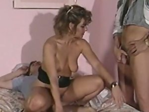 Vintage babe stuffed by three cocks