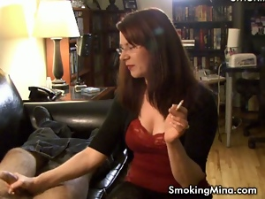 Watch her jerking cock and smoking together.