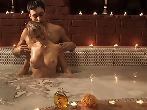 Young couple enjoy bath and blowjob