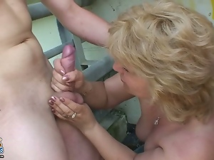 Euro granny gets fucked outdoors in a threesome