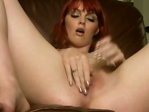 Sexy redhead marie mccray fingers her clam