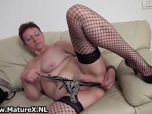 Old busty and horny mom is wanking her pussy while squeezing and licking her big boobs