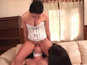 Girls in corsets sit on his face and give footjob