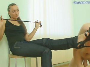He worships the feet of clothed mistress