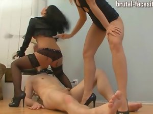 Abused by mistresses as he licks pussy