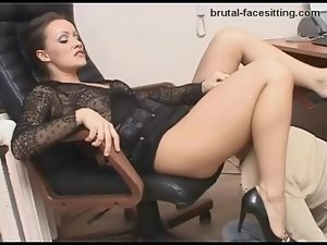 Gorgeous mistress in a skirt needs worship in office