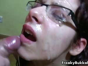 Filthy brunette whore gets her glasses covered with cum in this bukkake fest