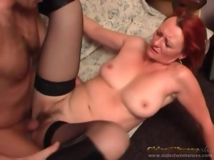 Mature redhead in stockings and boots fucked