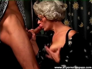 Gray hair granny on her knees sucking cock