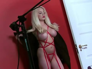 Busty bleach blonde bimbo poses in lipstick