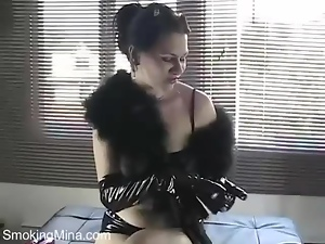 Smoking in shiny black latex gloves
