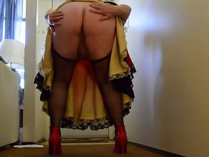 Sissy Ray in Red Taffeta Skirt and gold petticoat in hotel