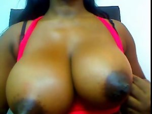 Filthy ebony Girlie with mega big melons and huge nipples teases