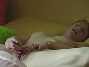 Sensual short haired girlie plys on the bed