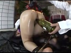 Asian tied. teased with bottle