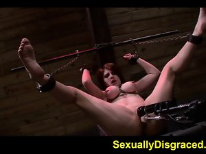 Chained up Velma DeArmond on a screwing machine with big dild