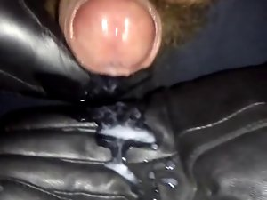 Jerking my puny prick with black leather gloves.