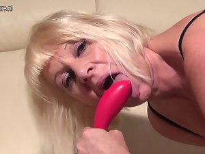 Older but lewd granny gets a phone call and masturbate