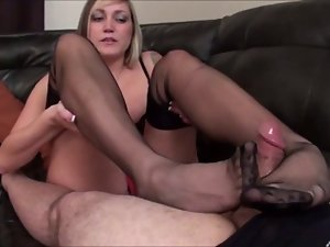 Sexual blond gives footjob in nylon