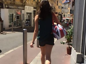 Following tiny dark haired in street with hidden cam