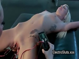 Clamped and electro shocked pussy