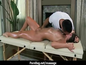 Sexual big-tit young woman is oiled up and shagged by her masseur 13
