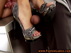 Solejob lady in heels gives footjob to black penis