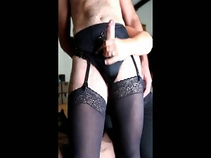 Dirty wife gives hubby a handjob while he wears the lingerie
