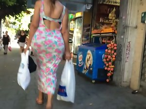 Bubble bum bouncing in skirt