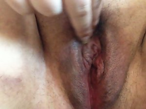 Rubbing my clit and fingering my shaved, plump, dampish vagina