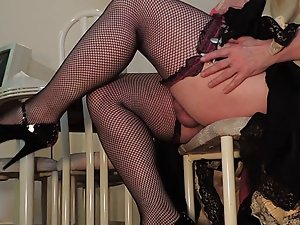 Sissy Ray in Red Dress and Fishnet Stockings