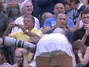 Sweaty tennis young woman bending over after match