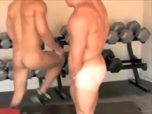 Nude gym buddies help each other out