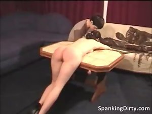 Filthy dark haired young woman gets spanked rough