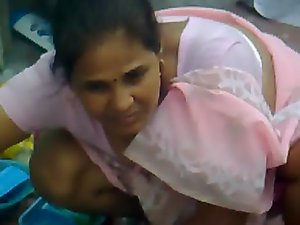 Pinkish saree aunty washing clothes 02