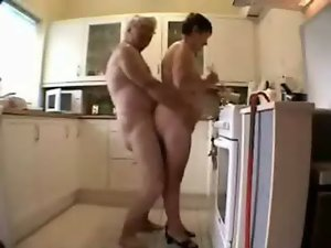 Older grand parents having fun in the kitchen. Amateur