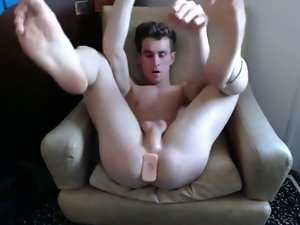 Twink taking big rubber toys in his butt