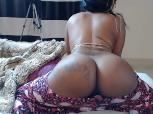 Ebony lassie with lush butt teasing on webcam